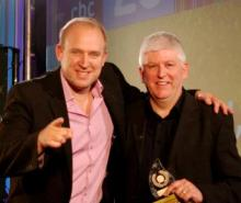 Friends and Heroes Marketing Director receives the award from Tim Vine